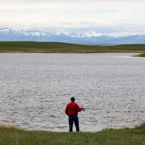 Fisherman at Arod Lakes with a beautiful view of the Rocky Mountain Front.